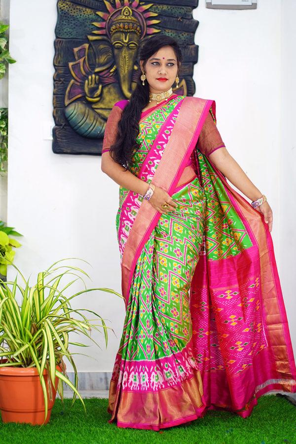Pochampally ikat allover green and pink kaddi border saree